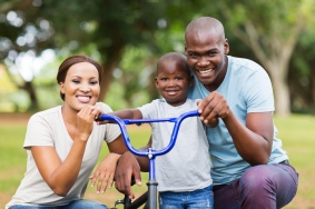 adorable afro american family having fun together outdoors